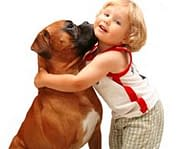 child hugging boxer